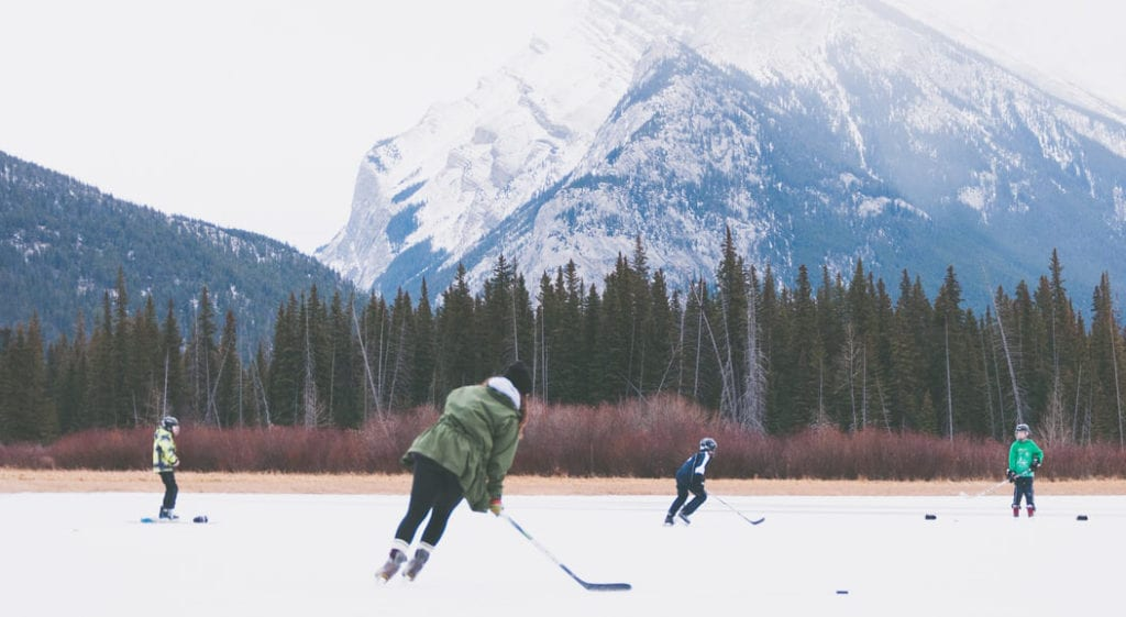 playing hockey outside with a mountain